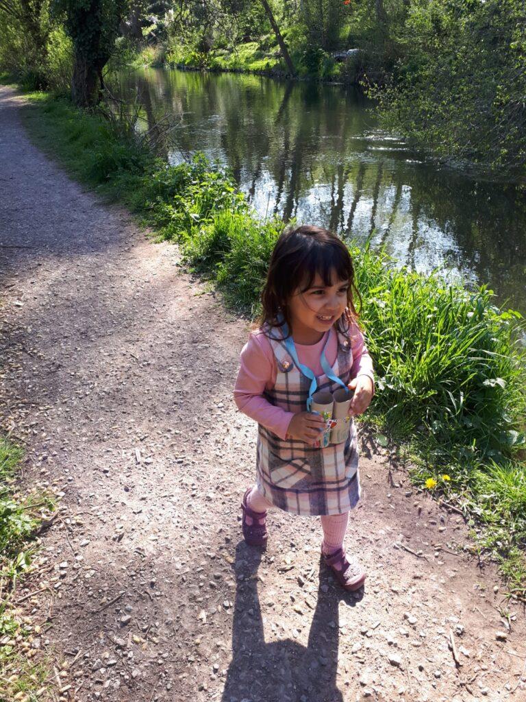 Girl walking next to river